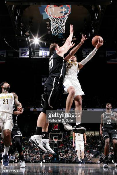 Jamal Murray of the Denver Nuggets goes to the basket against the Brooklyn Nets on October 29 2017 at Barclays Center in Brooklyn New York NOTE TO...