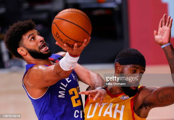 Jamal Murray of the Denver Nuggets goes up for a shot against Royce O'Neale of the Utah Jazz during the second quarter in Game Three of the Western...