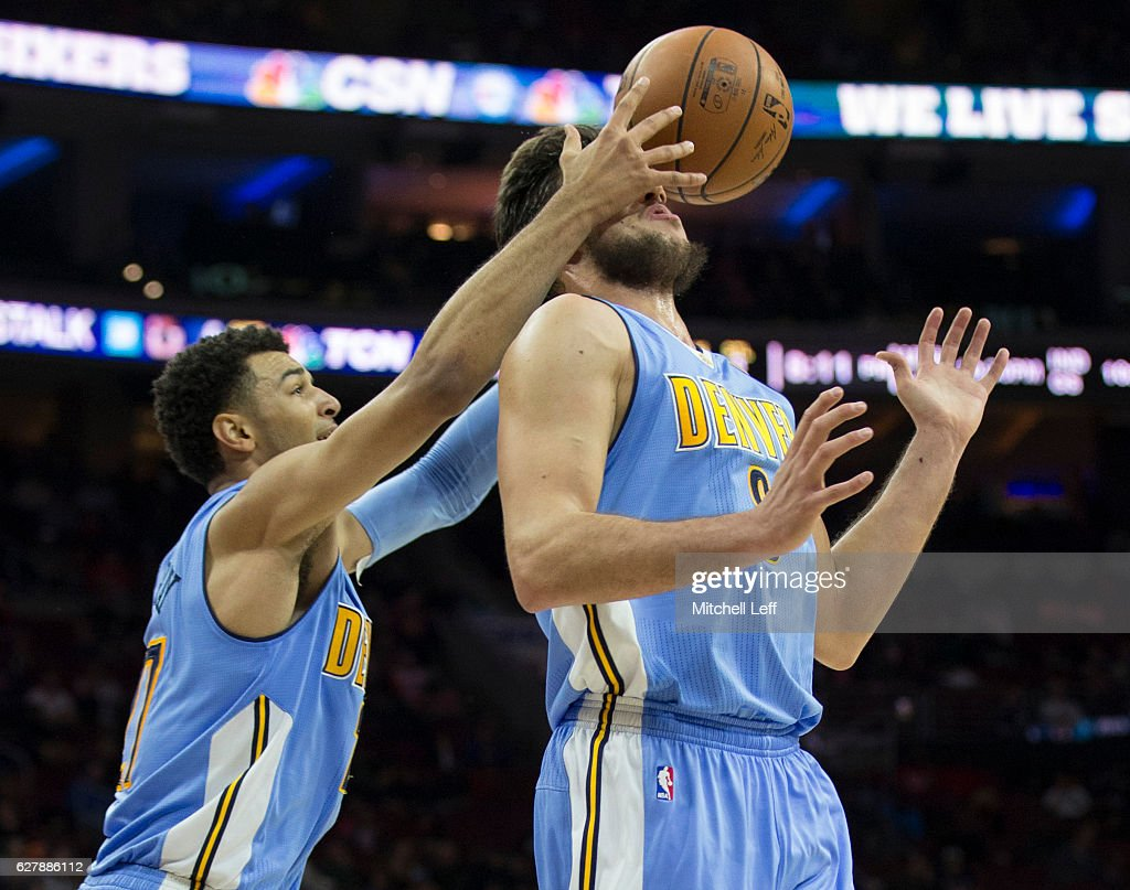 Jamal Murray #27 of the Denver Nuggets grabs a rebound off the face of Danilo Gallinari #8 in the second quarter against the Philadelphia 76ers at Wells Fargo Center on December 5, 2016 in Philadelphia, Pennsylvania.
