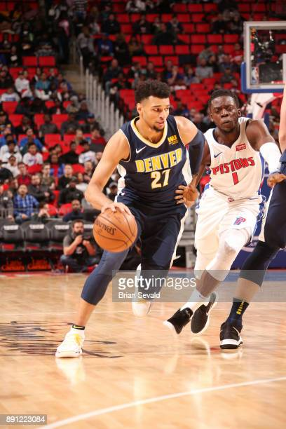 Jamal Murray of the Denver Nuggets handles the ball against Reggie Jackson of the Detroit Pistons on December 12 2017 at Little Caesars Arena in...