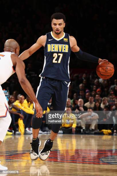 Jamal Murray of the Denver Nuggets handles the ball against the New York Knicks on October 30 2017 at Madison Square Garden in New York City New York...
