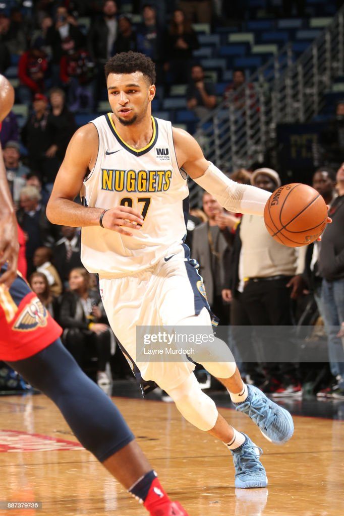 Jamal Murray #27 of the Denver Nuggets handles the ball against the New Orleans Pelicans on December 6, 2017 at Smoothie King Center in New Orleans, Louisiana.