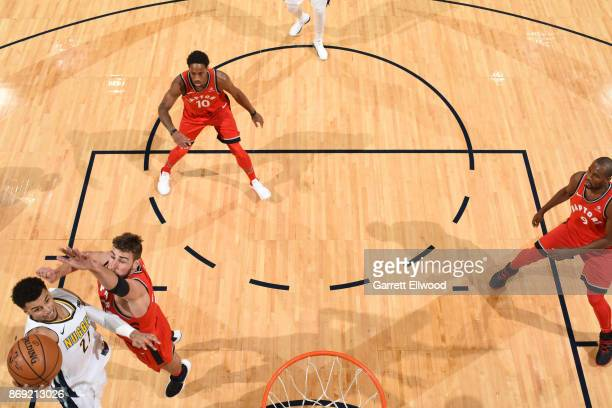Jamal Murray of the Denver Nuggets handles the ball against the Toronto Raptors on November 1 2017 at the Pepsi Center in Denver Colorado NOTE TO...