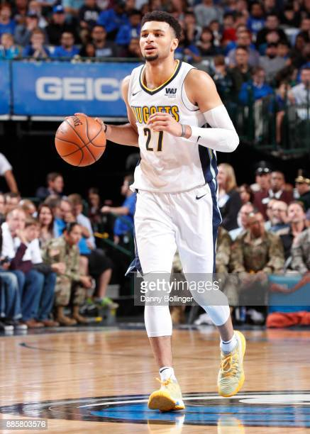 Jamal Murray of the Denver Nuggets handles the ball against the Dallas Mavericks on December 4 2017 at the American Airlines Center in Dallas Texas...