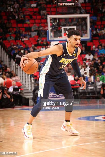 Jamal Murray of the Denver Nuggets handles the ball against the Detroit Pistons on December 12 2017 at Little Caesars Arena in Detroit Michigan NOTE...