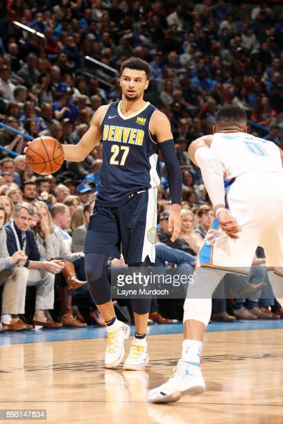 Jamal Murray of the Denver Nuggets handles the ball during the game against the Oklahoma City Thunder on December 18 2017 at Chesapeake Energy Arena...