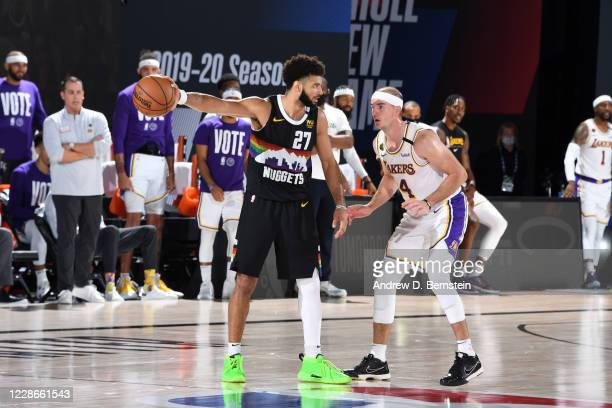 Jamal Murray of the Denver Nuggets handles the ball while Alex Caruso of the Los Angeles Lakers plays defense during Game Three of the Western...