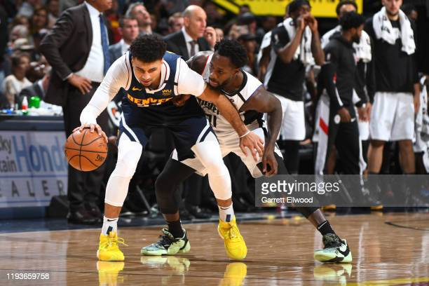 Jamal Murray of the Denver Nuggets handles the ball while Patrick Beverley of the LA Clippers plays defense during the game on January 12, 2020 at...