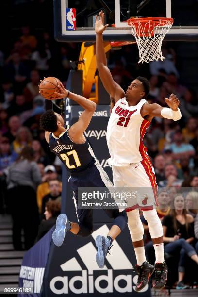 Jamal Murray of the Denver Nuggets has his shot blocked by Hassan Whiteside of the Miami Heat at the Pepsi Center on November 3 2017 in Denver...