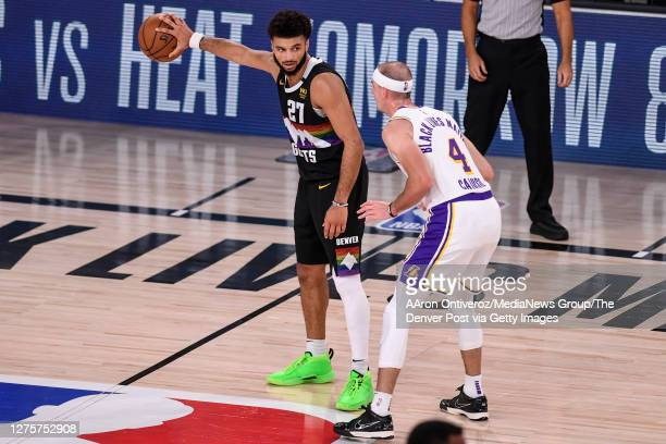 Jamal Murray of the Denver Nuggets holds the ball away from Alex Caruso of the Los Angeles Lakers during the fourth quarter of Denver's 114106 win at...