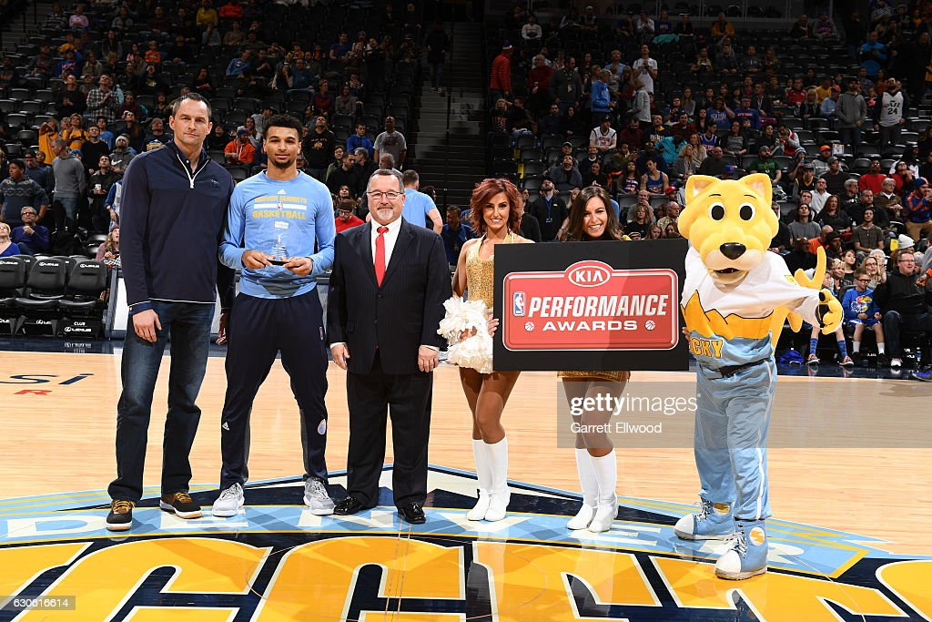 Jamal Murray #27 of the Denver Nuggets is presented with the KIA Sports Performance Awards Rookie of the Month before the game against the New York Knicks on December 17, 2016 at the Pepsi Center in Denver, Colorado.