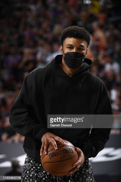 Jamal Murray of the Denver Nuggets looks on during Round 2, Game 2 of the NBA Playoffs on June 9, 2021 at Phoenix Suns Arena in Phoenix, Arizona....