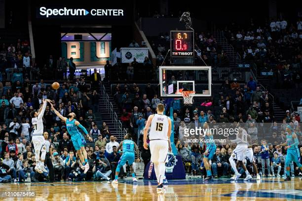 Jamal Murray of the Denver Nuggets makes the game winning shot in the final seconds of the fourth quarter during their game against the Charlotte...