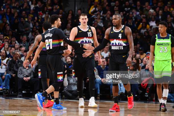 Jamal Murray of the Denver Nuggets Nikola Jokic of the Denver Nuggets and Paul Millsap of the Denver Nuggets high five during the game against the...