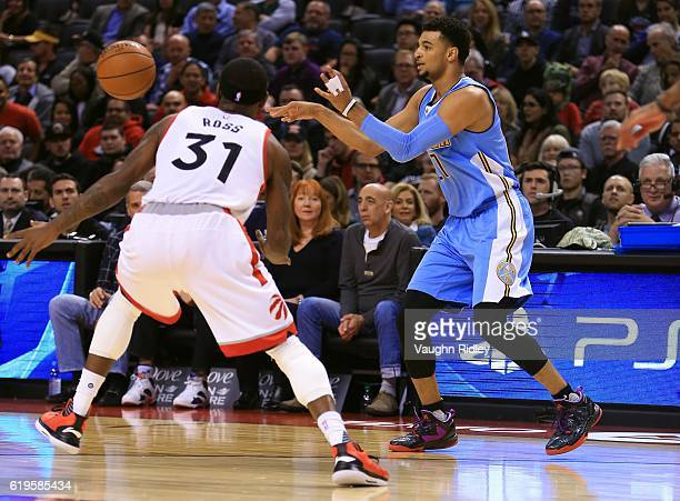 Jamal Murray of the Denver Nuggets passes the ball during the first half of an NBA game against the Toronto Raptors at Air Canada Centre on October...