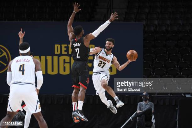 Jamal Murray of the Denver Nuggets passes the ball during the game against David Nwaba of the Houston Rockets on December 28, 2020 at the Pepsi...