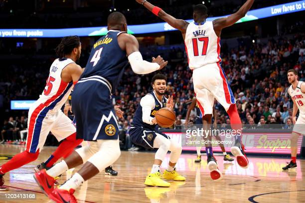 Jamal Murray of the Denver Nuggets passes to Paul Millsap against the Detroit Pistons at Pepsi Center on February 25 2020 in Denver Colorado NOTE TO...