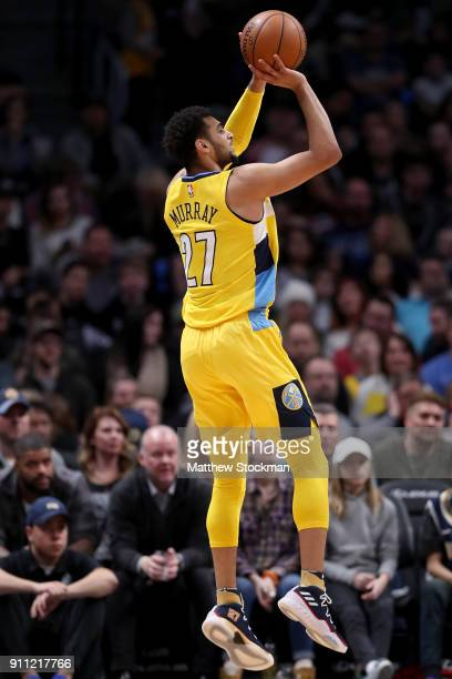 Jamal Murray of the Denver Nuggets puts up a shot against the Dallas Mavericks at the Pepsi Center on January 27 2018 in Denver Colorado NOTE TO USER...