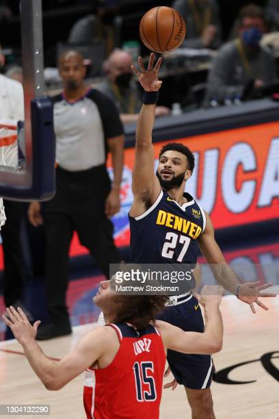Jamal Murray of the Denver Nuggets puts up a shot over Robin Lopez of the Washington Wizards in the second quarter at Ball Arena on February 25, 2021...