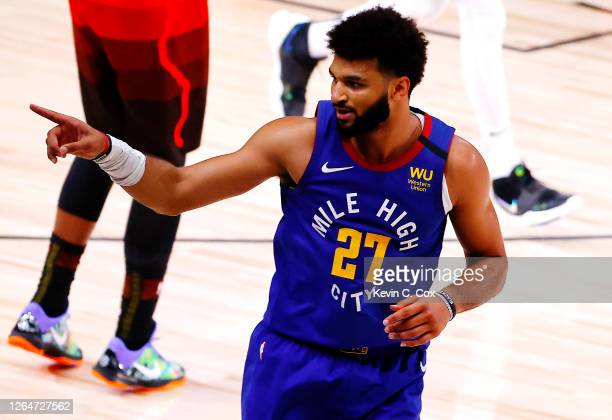 Jamal Murray of the Denver Nuggets reacts after a three point basket against the Utah Jazz during double overtime at The Arena at ESPN Wide World Of...