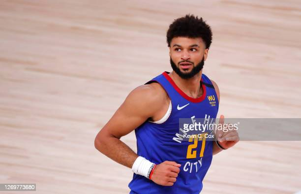 Jamal Murray of the Denver Nuggets reacts after shooting a three point basket against the Utah Jazz during the second quarter in Game Six of the...