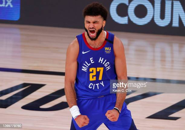 Jamal Murray of the Denver Nuggets reacts after shooting a three point basket against the Utah Jazz during the fourth quarter in Game Six of the...