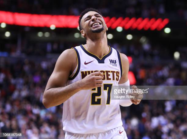 Jamal Murray of the Denver Nuggets reacts after the Nuggets take the lead late in the second half of an NBA game against the Toronto Raptors at...