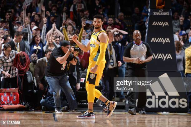 Jamal Murray of the Denver Nuggets reacts to a play during the game against the Dallas Mavericks on January 27 2018 at the Pepsi Center in Denver...