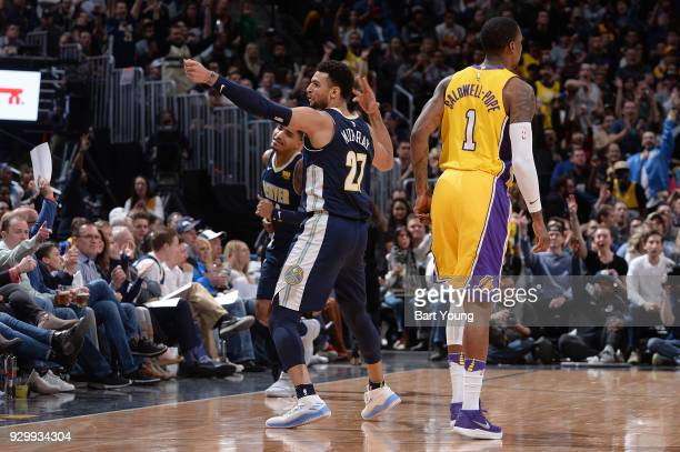 Jamal Murray of the Denver Nuggets reacts to a play during the game against the Los Angeles Lakers on March 9 2018 at the Pepsi Center in Denver...
