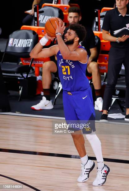 Jamal Murray of the Denver Nuggets shoots a three point basket against the Utah Jazz during the fourth quarter in Game Four of the Western Conference...