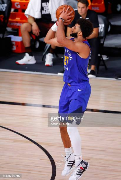 Jamal Murray of the Denver Nuggets shoots a three point basket against the Utah Jazz during the fourth quarter in Game Six of the Western Conference...