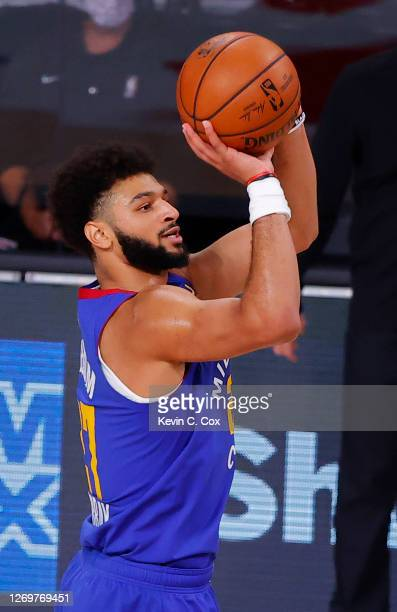 Jamal Murray of the Denver Nuggets shoots a three point shot against the Utah Jazz during the first quarter in Game Six of the Western Conference...