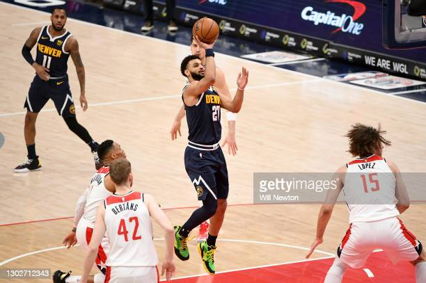 Jamal Murray of the Denver Nuggets shoots against the Washington Wizards during the first half at Capital One Arena on February 17, 2021 in...