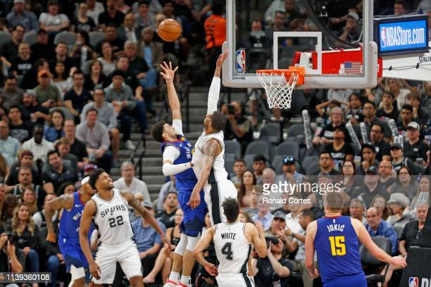 Jamal Murray of the Denver Nuggets shoots over LaMarcus Aldridge of the San Antonio Spurs during Game Six of the first round of the 2019 NBA Western...