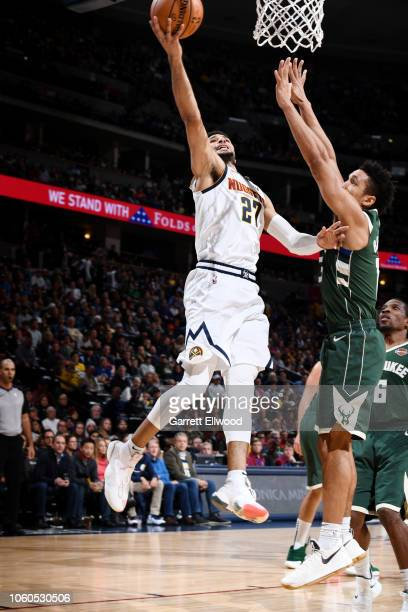 Jamal Murray of the Denver Nuggets shoots the ball during the game against the Milwaukee Bucks on November 11 2018 at the Pepsi Center in Denver...