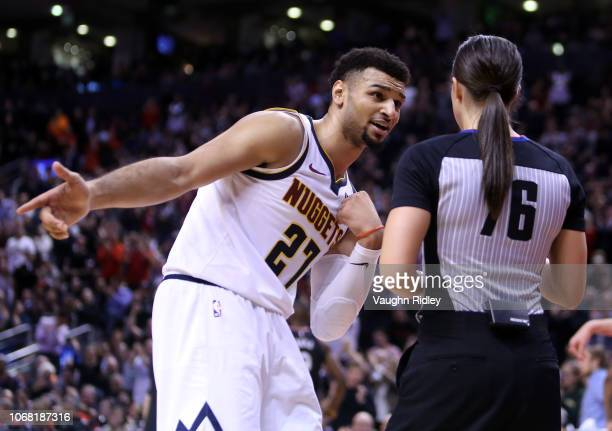 Jamal Murray of the Denver Nuggets speaks to an official during the second half of an NBA game against the Toronto Raptors at Scotiabank Arena on...