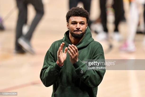 Jamal Murray of the Denver Nuggets walks off the court after action against the Phoenix Suns in Game Four of the Western Conference second-round...