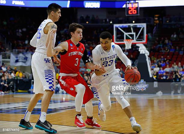 Jamal Murray of the Kentucky Wildcats drives against Kameron Mitchell of the Stony Brook Seawolves in the second half during the first round of the...
