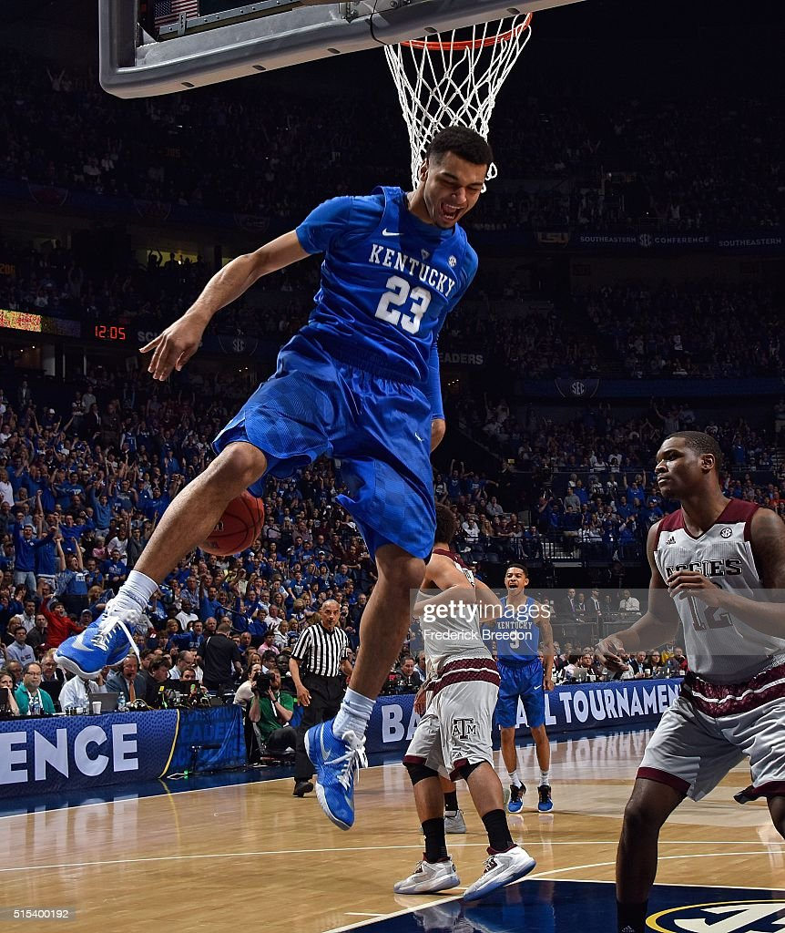 Jamal Murray #23 of the Kentucky Wildcats reacts after a slam dunk against Jalen Jones #12 of of the Texas A&M Aggies during the first half of the SEC Basketball Tournament Championship at Bridgestone Arena on March 13, 2016 in Nashville, Tennessee.