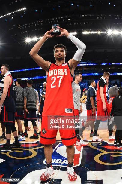 Jamal Murray of the World Team receives the MVP trophy after defeating the USA Team during the BBVA Compass Rising Stars Challenge as part of 2017...