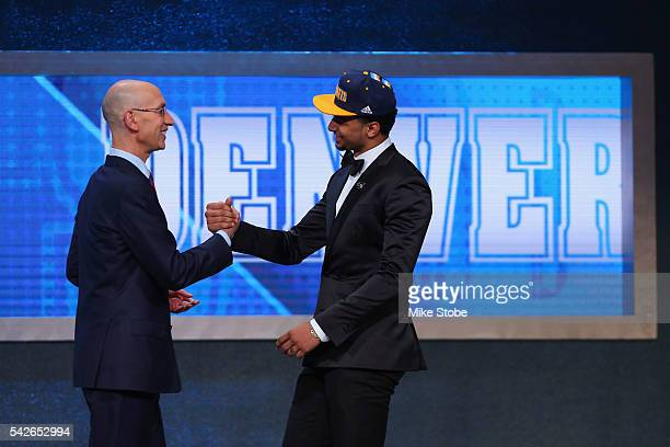 Jamal Murray shakes hands with Commissioner Adam Silver after being drafted seventh overall by the Denver Nuggets in the first round of the 2016 NBA...