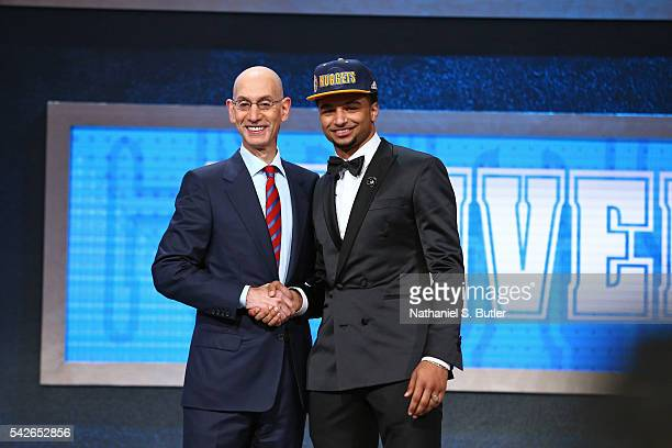 Jamal Murray shakes hands with NBA Commissioner Adam Silver after being selected number seven overall by the Denver Nuggets during the 2016 NBA Draft...