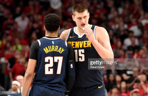 Jamal Murray speaks with teammate Nikola Jokic of the Denver Nuggets during the second half of game four of the Western Conference Semifinals against...