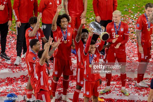 Jamal Musiala of Bayern Muenchen cheers after winning the Supercup after the UEFA Super Cup match between FC Bayern Munich and FC Sevilla at Puskas...