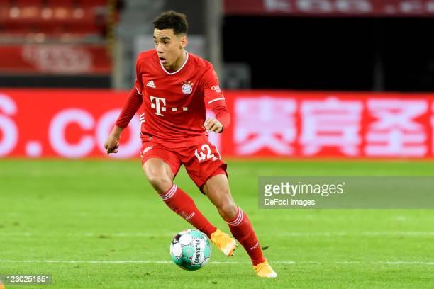 Jamal Musiala of Bayern Muenchen controls the ball during the Bundesliga match between Bayer 04 Leverkusen and FC Bayern Muenchen at BayArena on...