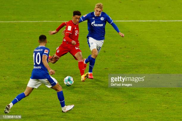 Jamal Musiala of Bayern Muenchen scores his team's eighth goal during the Bundesliga match between FC Bayern Muenchen and FC Schalke 04 at Allianz...