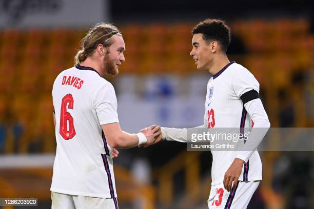 Jamal Musiala of England celebrates with teammate Tom Davies after scoring their team's third goal during the UEFA Euro Under 21 Qualifier match...