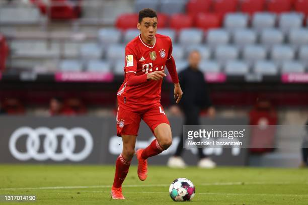 Jamal Musiala of FC Bayern München runs with the ball during the Bundesliga match between FC Bayern Muenchen and Borussia Moenchengladbach at Allianz...