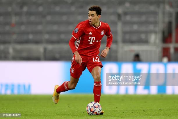 Jamal Musiala of FC Bayern München runs with the ball during the UEFA Champions League Group A stage match between FC Bayern Muenchen and Lokomotiv...