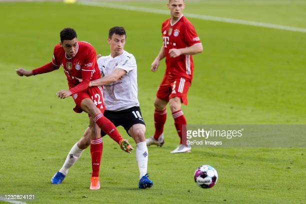 Jamal Musiala of FC Bayern Muenchen and Stefan Lainer of Borussia Moenchengladbach battle for the ball during the Bundesliga match between FC Bayern...